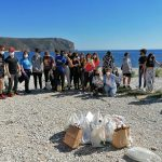 High schools come together to help clean up the coast